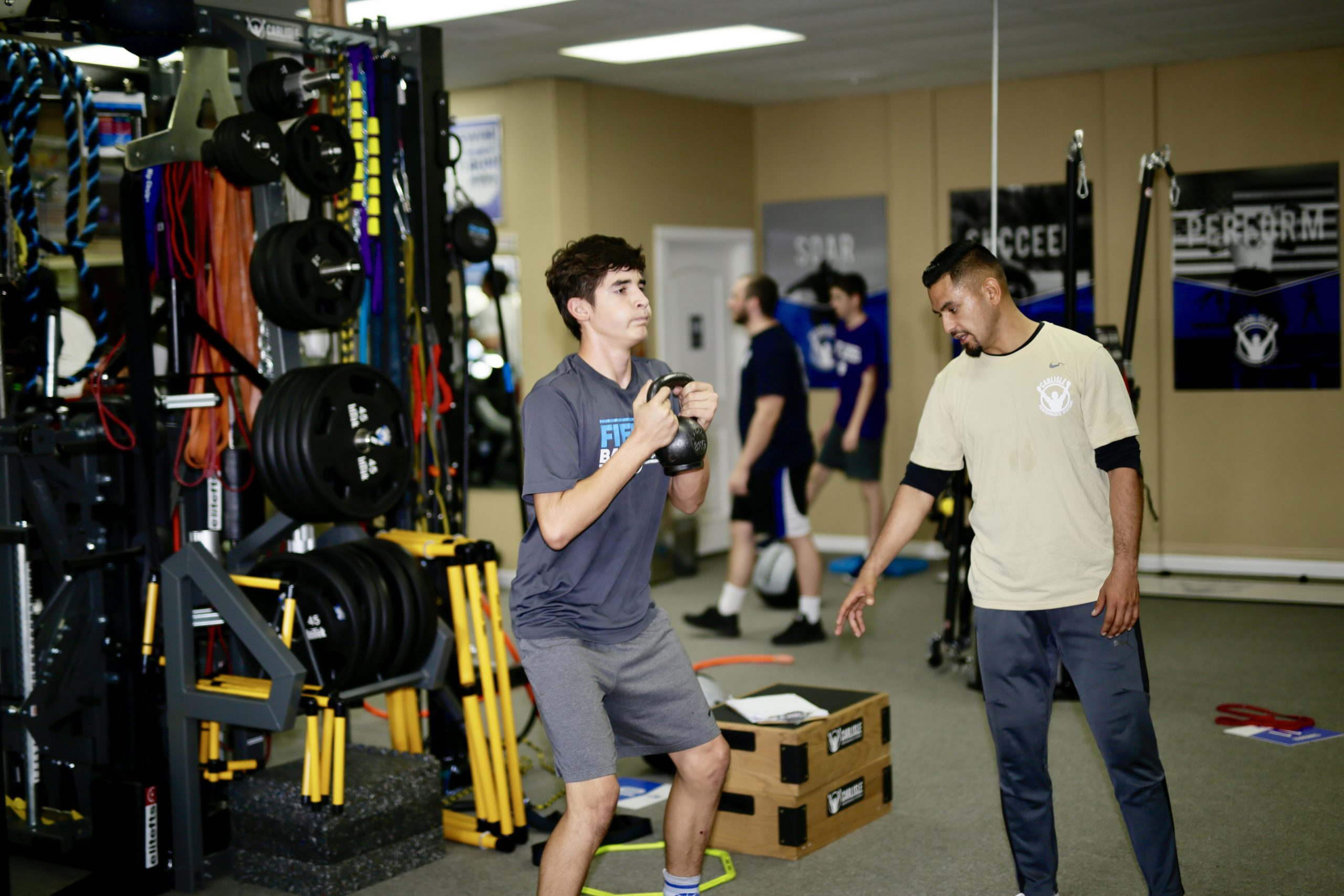 Speed coach and personal trainer Yimi Chombo training a youth athlete at Carlisle Performance